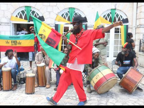 Rastafarians in Sam Sharpe Square, Montego Bay, protest on Thursday against state Injustice in the wake of the alleged forcible haircut of an adherent at the Four Paths Police Station in Clarendon.