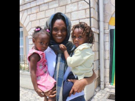 Rastafarian Portia Burnett with her twins, Natti Bennett and I-lumi Bennett.