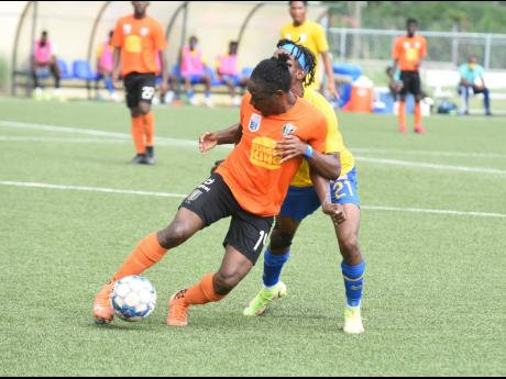 Tivoli Gardens' Kemar Flemmings (front) turns away from Harbour View's Odorland Harding during their Jamaica Premier League game at the UWI/JFF Captain Horace Burrell Centre of Excellence in St Andrew on Saturday.