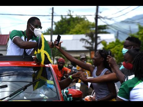 It was a hero's homecoming for Hansle Parchment, Olympic gold medallist in the 110m hurdles at the Tokyo Games, in his birth parish of St Thomas yesterday.