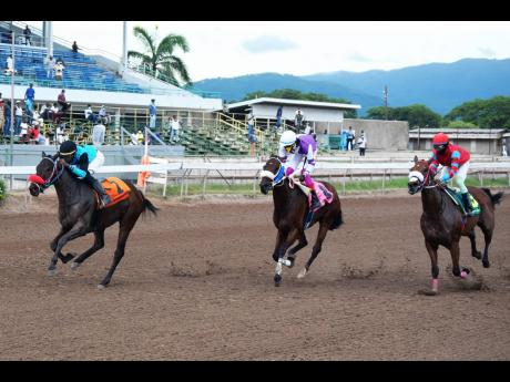 LOOSE BALL (left), ridden by Tevin Foster, created a mild upset at 8-1 odds and wins the eighth race over five furlongs straight at Caymanas Park, yesterday.