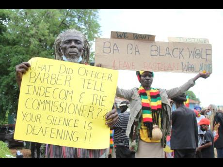 Members of the Nyabingi Order protest close to the Four Paths Police Station in Clarendon, seeking answers on an alleged case of a police officer trimming the dreadlocks of Rastafarian teen Nzinga King while she was in police custody.