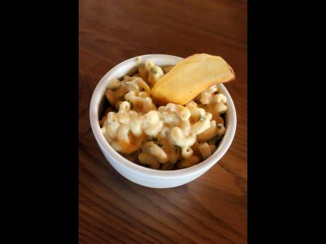 Macaroni and cheese is a tasty side dish for meat smoked or grilled over an open flame.