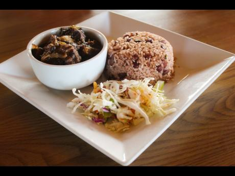 Not adventurous? This local entrée of oxtail, braised with beans, served with traditional rice and peas will still send your taste buds around the globe and back.