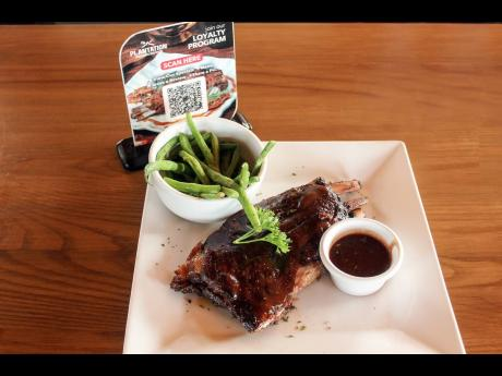 Plantation Smokehouse invites all pork lovers to pass by, get cosy and put their money where their mouths are with an order or two of its prize-winning ribs glazed with barbecue sauce.