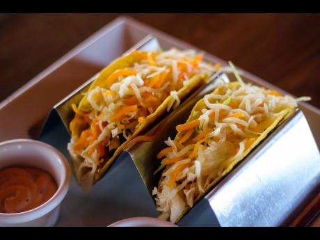 A tender white fish fillet resting in-between a hard-shell taco, cabbage, onions and a blend of a variety of cheeses, then passed through the oven gives the stomach that warm, satisfied feeling.