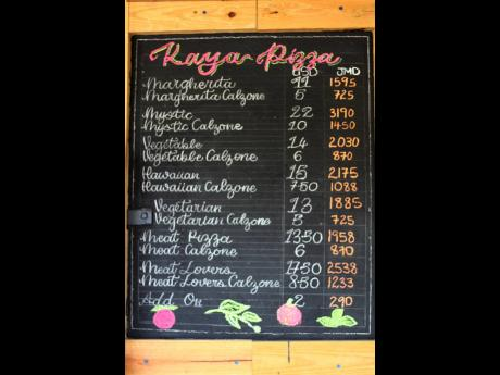 The menu board at Kaya Pizza, located on Lady Musgrave Road, is filled with options.