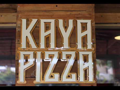 In big, bold letters, the Kaya Pizza sign welcomes customers.