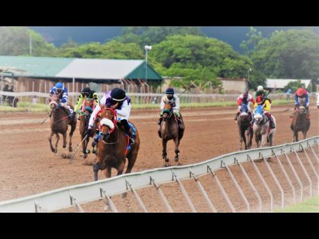 AS YOU WISH (foreground), ridden by Matthew Bennett, wins the fourth race over nine furlongs and 20 yards at Caymanas Park on Monday.