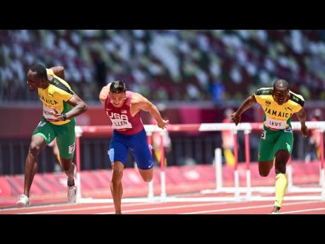 Jamaica's Hansle Parchment (left) takes the gold medal, while teammate Ronald Levy (right) takes bronze during the men's 110m hurdles final at the Olympic Games in Tokyo, Japan, on Thursday, August 5. Also pictured is USA's Devon Allen, who was fourt