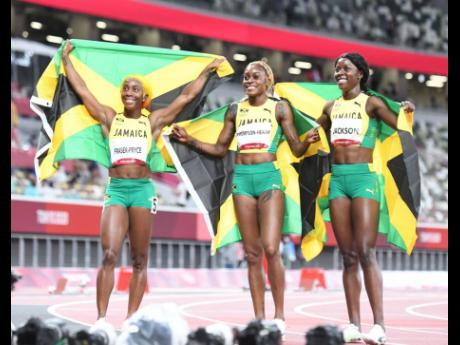 Jamaica's three medallists in the women's 100m final at the Olympic Games, (from left) Shelly-Ann Fraser-Pryce (silver), Elaine Thompson Herah (gold), and Shericka Jackson (bronze) on Saturday, July 31.
