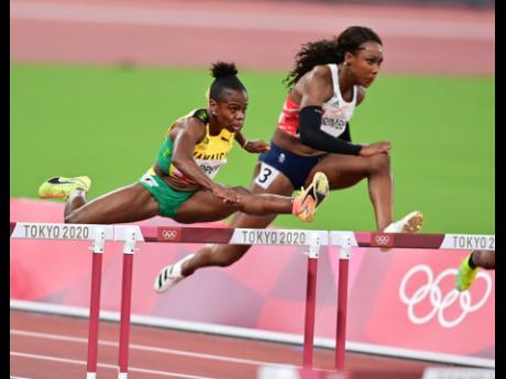Sprint hurdler Megan Tapper (left) clears a hurdle ahead of Great Britain's Cindy Sember in the women's 100m hurdles semi-final at the Olympic Games in Tokyo, Japan, on Sunday, August 1. Tapper went on to claim bronze in the final.