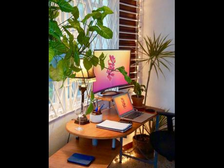 A home office can benefit from having a few potted plants whether on the table, floor or hanging from the ceiling.