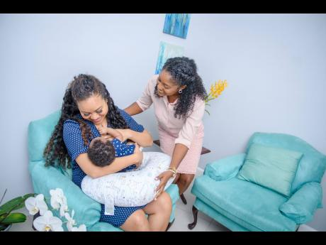 Certified Breastfeeding Specialist Ruth-Ann Taylor (right) checks in on patient Xinyu Addae-Lee. Certified Breastfeeding Specialist Ruth-Ann Taylor (right) checks in on patient Xinyu Addae-Lee. Certified Breastfeeding Specialist Ruth-Ann Taylor (right) che