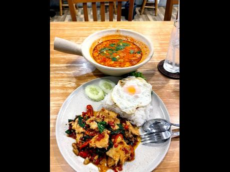 Frying Pan also serves Thai food all day. Here's a closer look at the fried chicken with basil and a fried egg.