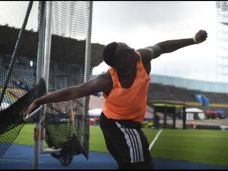 Ralford Mullings competing in the under-20 boys' discus throw event at the National Junior Championships at the National Stadium on Friday, June 25.