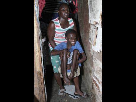 Roxanne Smith and her eldest child Zenda.