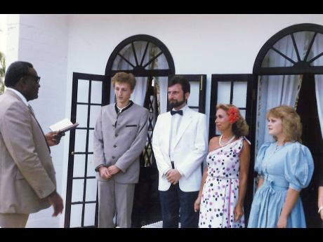 The Rev Conrad Pitkin officiates at the wedding of Alfred Vlaschitz (centre) and wife Renate, alongside two witnesses, at their wedding ceremony 35 years ago at Half Moon in Montego Bay.