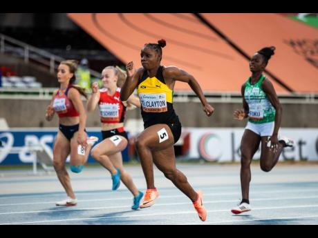 Jamaica's Tina Clayton (second right) powering to victory in the women's 100 metres final at the World Under-20 Championships in Nairobi, Kenya, yesterday. Clayton won in a personal best 11.09 seconds. Zimbabwe's Beatrice Masilingi (not in photo) was