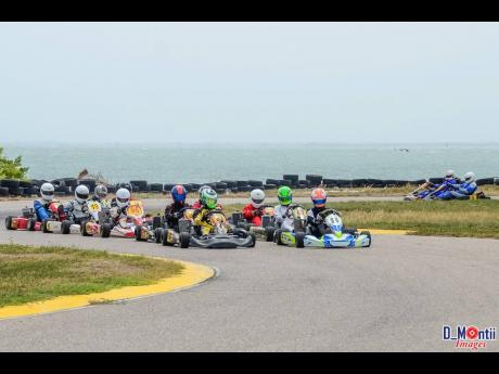 A bunched up pack of karters get ready to take the green flag at the Palisadoes Gokart track.