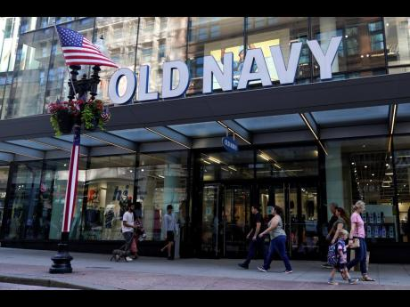 Pedestrians pass by the Old Navy store on July 14, 2021, in the Downtown Crossing shopping area in Boston.