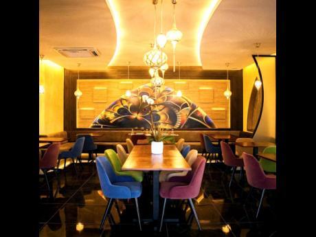 Chez Maria's interior design was created by New York-based interior designer Peta Gaye Shoucair.
