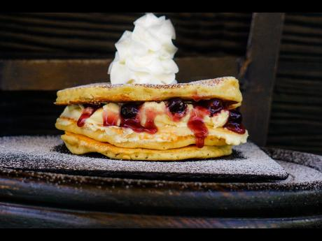 The premium blueberry pancakes are a whole experience, from the look to the taste.