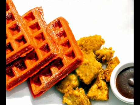 Red velvet waffles served with chicken is a meal that both adults and children will feel satisfied with eating at any time of the day.