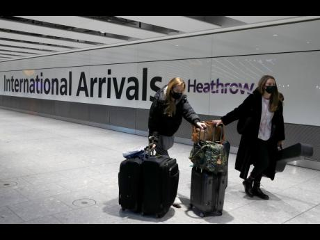 In this January 17, 2021 photo, travellers arrive at Heathrow Airport in London. Fuelled by a third wave of COVID-19, 'red list' designation for Jamaica could send tourism fortunes tanking again.