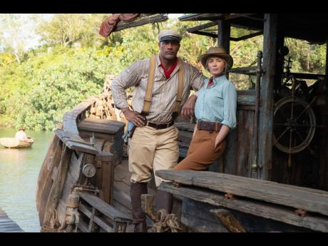 Dwayne Johnson as Frank and Emily Blunt as Lily in 'Jungle Cruise'.