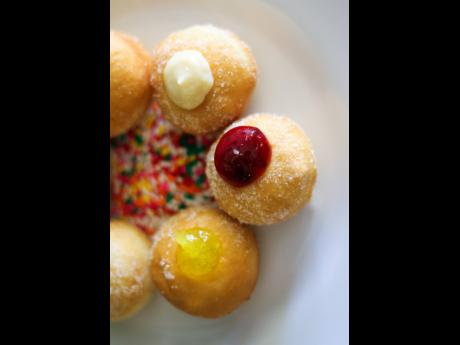 These doughnut holes filled with fruity preserves, are bite-sized versions of the fried pastry.