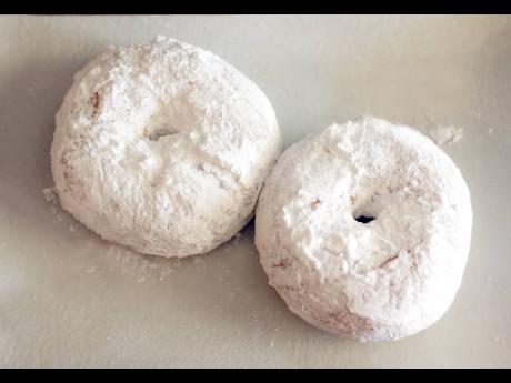 Doughnuts dusted with powdered sugar are a heavenly treat.