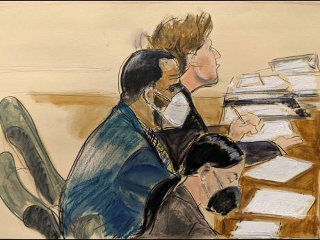 R Kelly (left), listens during his trial in New York.