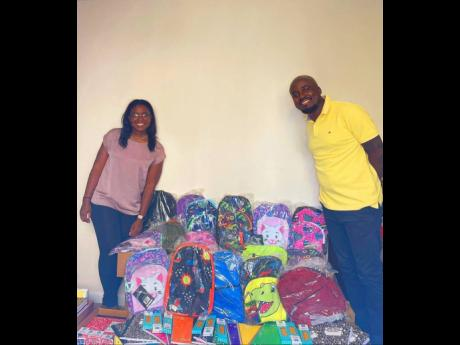 Konteh (right), and his team, plans to deliver school supplies to 500 students for the upcoming school term.