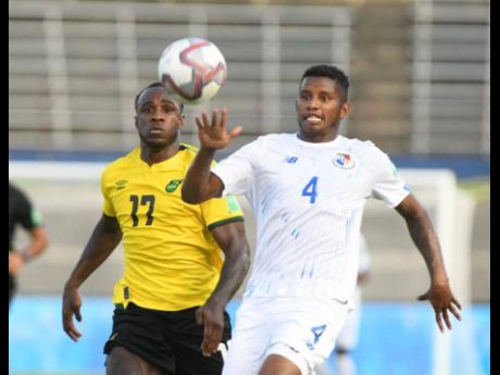 Jamaica's Michail Antonio (left) challenges Panama's Fidel Escobar for the ball during their FIFA World Cup Qualifying match at the National Stadium in Kingston on Sunday.