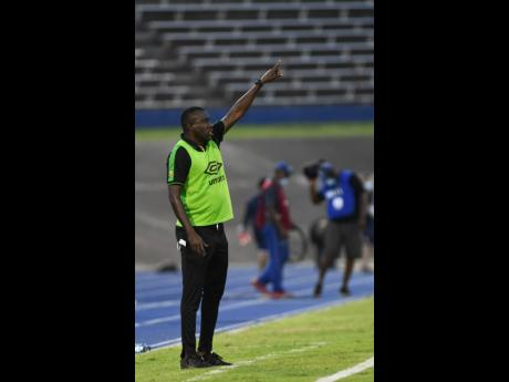 Jamaica's National team coach Theodore Whitmore shouting instructions from the sidelines during Sunday night's Concacaf World Cup qualification match against Panama at the National Stadium. Panama won 3-0.