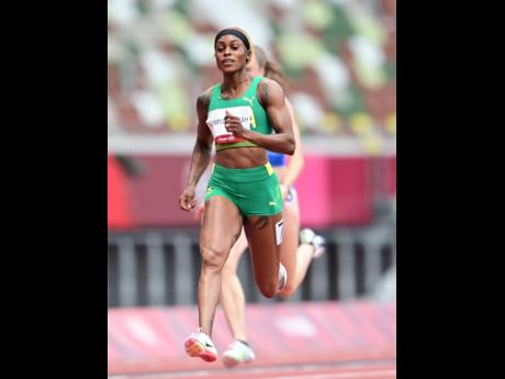 Jamaica's Elaine Thompson-Herah competes in her heat in the women's 100 metres event at the Tokyo 2020 Olympic Games.