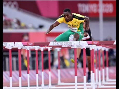 Hansle Parchment competing in the men's 110 metres hurdles at the Tokyo 2020 Olympics.
