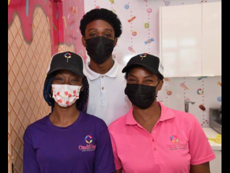 Cheery Staff at Candy Craze in Progressive Mall, Barbican Road, are (from left) Jodene Pusey, Robert Brooks and Petagayle Johnson.