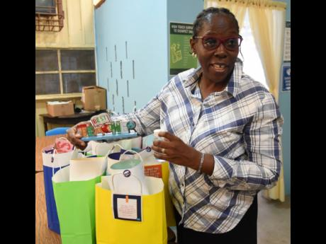 Josette Doyley, principal of Spring Gardens Primary School in St Thomas, preparing gift bags for her teachers as they return to school.