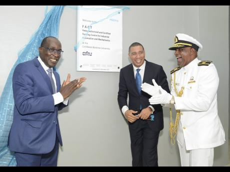 Prime Minister Andrew Holness (centre) is seen here with Ruel Reid and Professor Fritz Pinnock at a September 2018 dedication ceremony at the Caribbean Maritime University. Reid and Pinnock are still earning millions annually while on leave because of a co