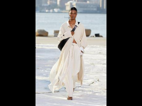 Swaying in the breeze, Naki Depass models this chic look from Peter Do.