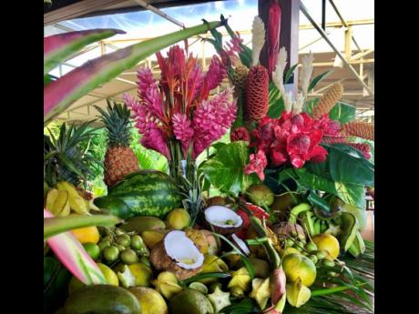A gorgeous arrangement of fruit and flowers curated by Doctor Bird Services for #MJW28.