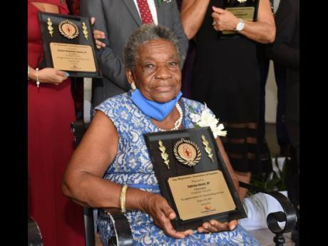 Justice of the peace since 1984, Sylveta Alcott from Clarendon was award at the 25th Annual Golden Scale Awards at Caymanas Golf Club on August 28.