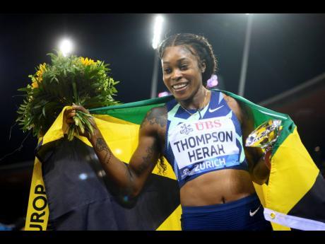 Elaine Thompson Herah celebrates after winning the women's 100 metres race during the Weltklasse IAAF Diamond League international athletics meeting at the Letzigrund stadium in Zuerich, Switzerland, yesterday. Thompson Herah clocked 10.65 seconds.