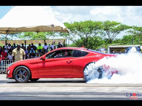 The Hyundai Genesis of Roland Crawford doing a burnout.