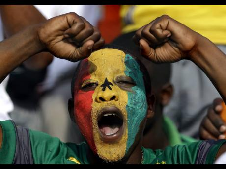 In this 2015 file photo Senegal soccer fan gestures during the African Cup of Nations between Ghana and Senegal. Caribbean countries, like Jamaica, can learn much from Ghana especially since there is a push to establish STEM schools islandwide. An importan