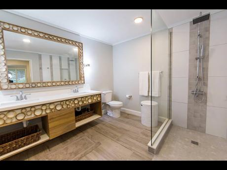 The primary bathroom features an ornate double vanity sink.