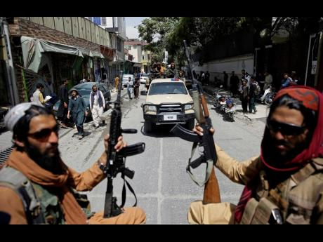 Taliban fighters patrol Kabul, Afghanistan. The Taliban celebrated Afghanistan's Independence Day by declaring they beat the United States, but challenges to their rule ranging from running a country severely short on cash and bureaucrats to potentially