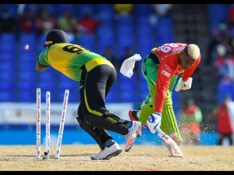 Shimron Hetmyer (right) of Guyana Amazon Warriors run out by Kennar Lewis (left) of Jamaica Tallawahs during the 2021 Hero Caribbean Premier League match at Warner Park Sporting Complex yesterday in Basseterre, Saint Kitts and Nevis. The Tallawahs lost by
